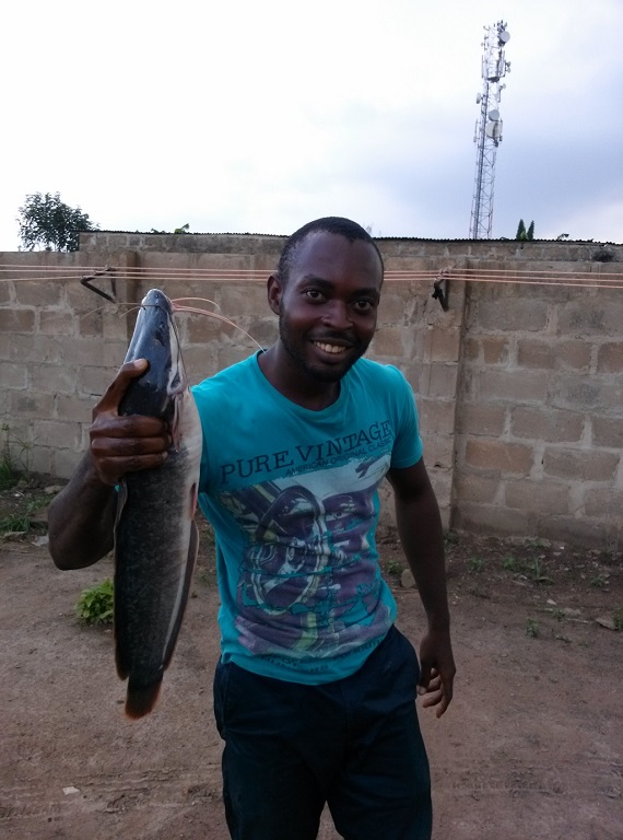 Dele holding 4 months old catfish